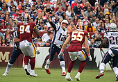 New England Patriots quarterback Tom Brady (12) releases a pass in the first quarter against the Washington Redskins at FedEx Field in Landover, Maryland on Sunday, October 6, 2019.  Defending on the play are Washington Redskins nose tackle Daron Payne (94) and linebacker Cole Holcomb (55).<br /> Credit: Ron Sachs / CNP