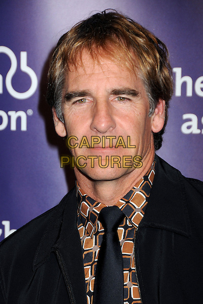 """SCOTT BAKULA .19th Annual """"A Night at Sardi's"""" Benefiting the Alzheimer's Association held at the Beverly Hilton Hotel, Beverly Hills, California, USA, 16th March 2011..portrait headshot black tie brown print shirt .CAP/ADM/BP.©Byron Purvis/AdMedia/Capital Pictures."""