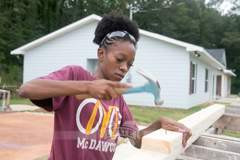 Service Dawgs volunteers working on the Habitat for Humanity house<br />  (photo by Beth Wynn / &copy; Mississippi State University)