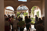 Tour group looking at the Patio de la Acequia, Court of the Water Channel, Generalife gardens, Alhambra, Granada, Spain