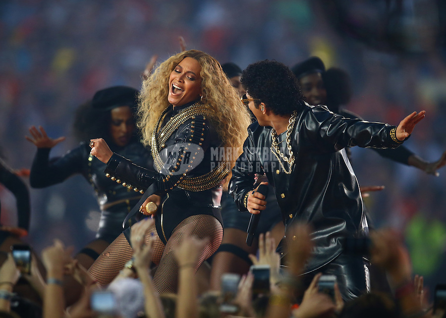 Feb 7, 2016; Santa Clara, CA, USA; Recording artist Beyonce performs with singer Bruno Mars during the half time show of the Denver Broncos game against the Carolina Panthers in Super Bowl 50 at Levi's Stadium. Mandatory Credit: Mark J. Rebilas-USA TODAY Sports