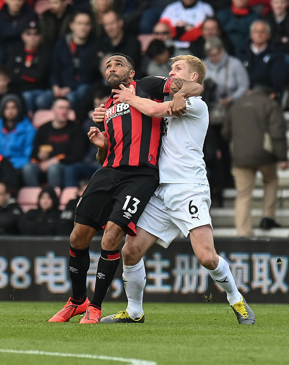 Burnley's Ben Mee (right) is tackled by Bournemouth's Callum Wilson (left) <br /> <br /> Photographer David Horton/CameraSport<br /> <br /> The Premier League - Bournemouth v Burnley - Saturday 6th April 2019 - Vitality Stadium - Bournemouth<br /> <br /> World Copyright © 2019 CameraSport. All rights reserved. 43 Linden Ave. Countesthorpe. Leicester. England. LE8 5PG - Tel: +44 (0) 116 277 4147 - admin@camerasport.com - www.camerasport.com