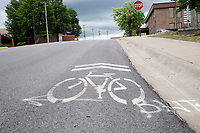 A bike lane marker is shown, Saturday, May 16, 2020 along Johnson Ave. in Springdale. Springdale will partner with the Downtown Springdale Association for sidewalk improvement on Johnson, Commercial and Spring streets. Check out nwaonline.com/200519Daily/ for today's photo gallery.<br />
