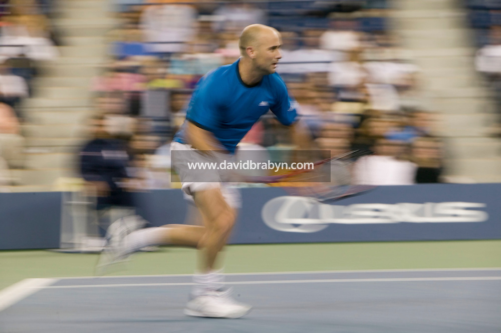 7 September 2005 - Flushing, NY - Andre Agassi plays fellow American James Blake in a quarterfinal match of the US tennis Open on the Arthur Ash court at the National Tennis Center in Flushing, USA, 7 September 2005. Agassi won 3-6, 3-6, 6-3, 6-3, 7-6. Photo Credit: David Brabyn