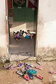Amazon. School room and flip-flops in an Arara Indian village.