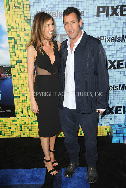 WWW.ACEPIXS.COM<br /> July 18, 2015 New York City<br /> <br /> Jackie Sandler and Adam Sandler attending the 'Pixels' Premiere at Regal E-Walk on July 18, 2015 in New York City.<br /> <br /> Please byline: Kristin Callahan/ACE <br /> <br /> <br /> Tel: (646) 769 0430<br /> e-mail: info@acepixs.com<br /> web: http://www.acepixs.com