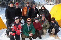 The volunteer crew at the Eagle Island checkpoint pose for a group photo on during Iditarod 2009