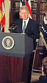 United States President Bill Clinton, on crutches, speaks on reducing Medicare and Medicaid fraud in the Roosevelt room of the White House in Washington, DC on March 25, 1997.<br /> Credit: Ron Sachs / CNP