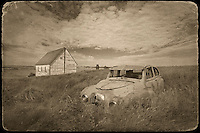 Abandoned car and church in prairie ghost town<br /> Neidpath<br /> Saskatchewan<br /> Canada