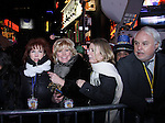 Broadway's Missy Keene (R) Victoria Regan (L) and friends in NYC's Times Square to see the ball drop at midnight to welcome 2014 after they attended the Times Square Broadway Royal on Dec 31 2013 and January 1, 2014. (Photo by Sue Coflin/Max Photos)