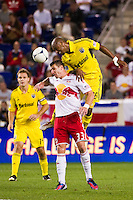 Julius James (26) of the Columbus Crew heads the ball over Kenny Cooper (33) of the New York Red Bulls. The New York Red Bulls defeated the Columbus Crew 3-1 during a Major League Soccer (MLS) match at Red Bull Arena in Harrison, NJ, on September 15, 2012.
