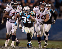Carolina Panthers running back DeAngelo Williams (34) runs downfield against the Denver Broncos during an NFL football game at Bank of America Stadium in Charlotte, NC.