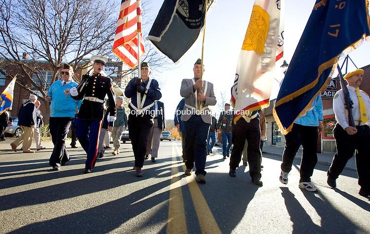 NAUGATUCK, CT. 11 November 2010-111110SV09--The Naugatuck Veterans Council color guard leads the Veterans Day parade down Church Street in Naugatuck Thursday.<br /> Steven Valenti Republican-American