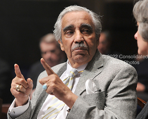 United States Representative Charles Rangel (Democrat of New York) has a conversation with an unidentified person as he awaits the arrival of U.S. President Barack Obama to deliver remarks to the House Democratic Caucus retreat at the U.S. Capitol Visitors Center in Washington, D.C. on Thursday, January 14, 2010..Credit: Ron Sachs / Pool via CNP