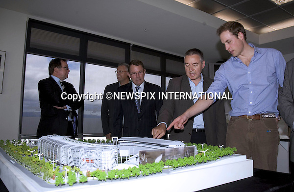 """PRINCE WILLIAM_views a model of the stadium.Prince William visited Eden Park rugby stadium on the first day of his official royal visit to New Zealand. During the visit the Prince toured the redevelopment site wearing a hard hat and florescent jacket with the New Zealand Prime Minister John Key.The Prince also participated in a game of catch with some youths from the local Pakuranga Rugby Club and meet Richie McCaw, Dan Carter, John Afoa, Ali Williams, Tony Woodcock, Keven Mealamn, Jerome Kaino and Anthony Boric from the current New Zealand All Blacks.Eden Park Rugby Stadium, Auckland_17/01/2010.Mandatory Credit Photo: ©DIAS-NEWSPIX INTERNATIONAL..**ALL FEES PAYABLE TO: """"NEWSPIX INTERNATIONAL""""**..IMMEDIATE CONFIRMATION OF USAGE REQUIRED:.Newspix International, 31 Chinnery Hill, Bishop's Stortford, ENGLAND CM23 3PS.Tel:+441279 324672  ; Fax: +441279656877.Mobile:  07775681153.e-mail: info@newspixinternational.co.uk"""