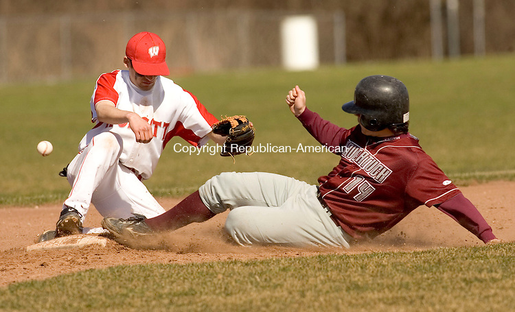 WOLCOTT, CT- 19 APRIL 2007-041907JS01-Naugatuck's Rick Cool is safe at second as the ball skips past Wolcott's Tom Jannetty during their game Thursday at Wolcott High School .-- --Jim Shannon Republican-American