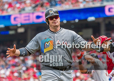 30 August 2015: Miami Marlins first baseman Justin Bour comes home to score after hitting a 3-run homer in the first inning against the Washington Nationals at Nationals Park in Washington, DC. The Nationals defeated the Marlins 7-4 in the third game of their 3-game weekend series. Mandatory Credit: Ed Wolfstein Photo *** RAW (NEF) Image File Available ***