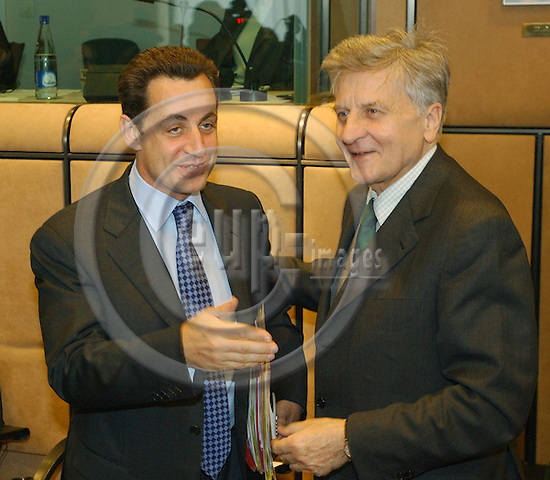 Brussels-Belgium - July 05, 2004---Meeting of the 'EUROGROUP'  at the 'Justus Lipsius', seat of the Council of the European Union in Brussels; here, Nicolas SARKOZY (le), French Minister for Finance and Economic Affairs, with Jean-Claude TRICHET (ri), President of the European Central Bank---Photo: Horst Wagner/eup-images