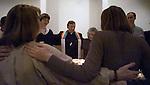 The chaplain interns form a circle during prayer at San Francisco General Hospital in California.