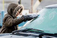 Tuesday  29 November 2016<br /> Pictured: Ryan Thomas aged 9 of Llangynog, Carmarthenshire  scrapes the ice from his mothers car before heading off to school<br /> Re:  Temperatures drop to below freezing across the UK on Monday night as the UK braces itself for a cold snap.