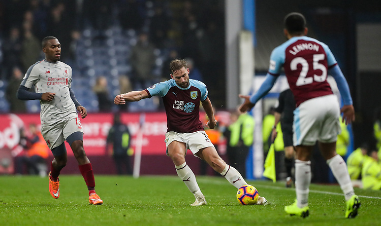 Burnley's Charlie Taylor crosses as Liverpool's Daniel Sturridge and Burnley's Aaron Lennon look on<br /> <br /> Photographer Andrew Kearns/CameraSport<br /> <br /> The Premier League - Burnley v Liverpool - Wednesday 5th December 2018 - Turf Moor - Burnley<br /> <br /> World Copyright © 2018 CameraSport. All rights reserved. 43 Linden Ave. Countesthorpe. Leicester. England. LE8 5PG - Tel: +44 (0) 116 277 4147 - admin@camerasport.com - www.camerasport.com