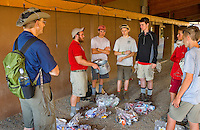 Photo story of Philmont Scout Ranch in Cimarron, New Mexico, taken during a Boy Scout Troop backpack trip in the summer of 2013. Photo is part of a comprehensive picture package which shows in-depth photography of a BSA Ventures crew on a trek. In this photo, a Ranger gives  instructions to a crew  about some of the equipment that they have just been issued at base camp at the Philmont Scout Ranch,  in Cimarron, New Mexico.<br /> <br /> Photo by travel photograph: PatrickschneiderPhoto.com