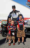 Sept. 6, 2010; Clermont, IN, USA; NHRA funny car driver Bob Tasca III with his sons during the U.S. Nationals at O'Reilly Raceway Park at Indianapolis. Mandatory Credit: Mark J. Rebilas-