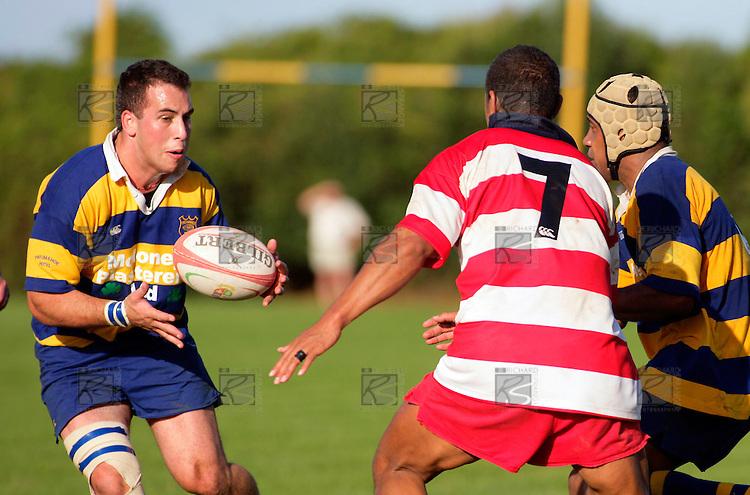 Carl Stephens about to get the ball and Karaka's S. Tuatoa together. Counties Manukau Premier Club Rugby, Patumahoe vs Karaka played at Patumahoe on Saturday 22nd April 2006. Karaka won 19 - 6.