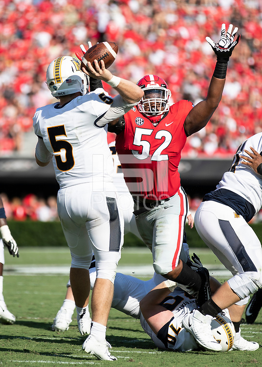 ATHENS, GA - SEPTEMBER 7: Preston Rice #5 passes over Georgia defender Tyler Clark #52 during a game between Murray State Racers and University of Georgia Bulldogs at Sanford Stadium on September 7, 2019 in Athens, Georgia.