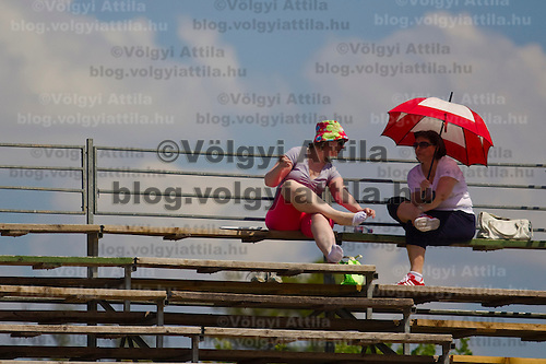 Visitors attend the Gaz de France Suez WTA tour Grand Prix international women tennis competition held at Roman Tennis Academy in Budapest, Hungary. Tuesday, 06. July 2010. ATTILA VOLGYI