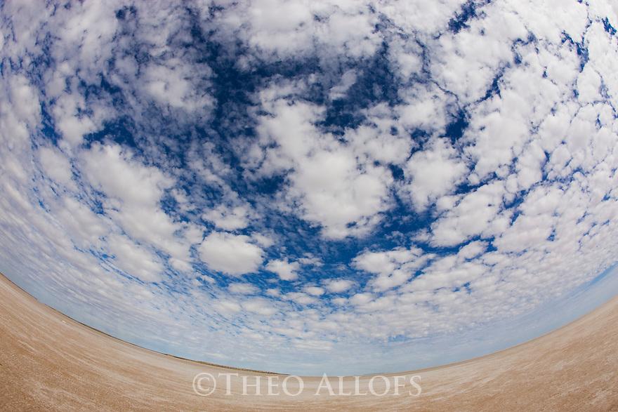 "Australia, South Australia;  clouds above dry salt lake ""Lake Eyre"", fisheye view"