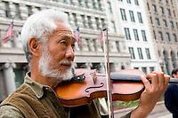 Street violin musician on Michigan Avenue in front of the Art Institute.  Chicago Illinois USA