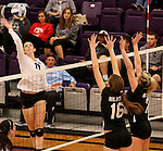SIOUX FALLS, SD - SEPTEMBER 23: Kate Hart #11 from University of Sioux Falls tips the ball against Alex Opperman #16 and Leisa McClintock #7 from Wayne State Tuesday night at the Stewart Center.  (Photo by Dave Eggen/Inertia)