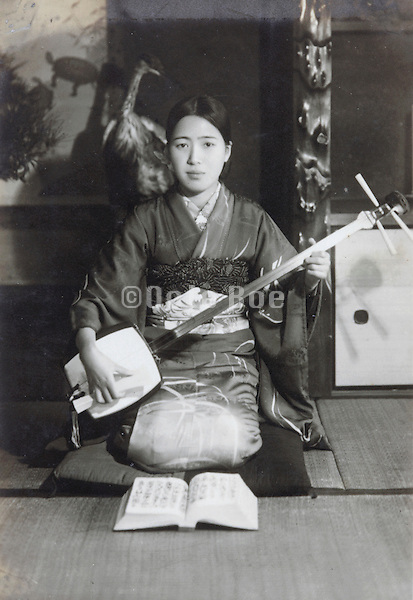Japanese young woman in kimono with a shamisen music instrument early 1930s