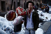 A man carries globes for his girlfriend during Valentine's Day in New York, Feb 14, 2014. VIEWpress/Eduardo Munoz Alvarez
