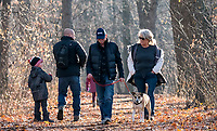 Blake and Suzanne Bywater walking their dog Louis through Tarzanland. Balmy Sunday Dec. 15 hike