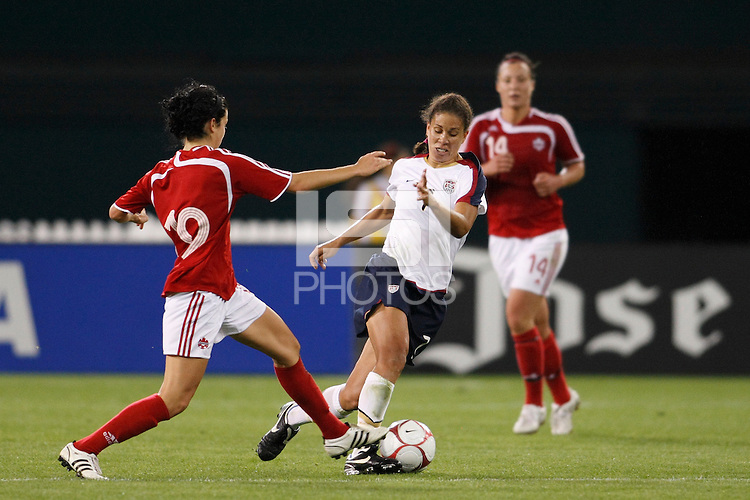 United States midfielder Shannon Boxx (7) is marked by Canada midfielder Jonelle Filigno (19). The women's national team of the United States defeated Canada 6-0 during an international friendly at Robert F. Kennedy Memorial Stadium in Washington, D. C., on May 10, 2008.