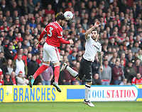 Nottingham Forest's Tobias Figueiredo in action with Derby County's Bradley Johnson<br /> <br /> Photographer Mick Walker/CameraSport<br /> <br /> The EFL Sky Bet Championship - Nottingham Forest v Derby County - Sunday 11th March 2018 - The City Ground - Nottingham<br /> <br /> World Copyright &copy; 2018 CameraSport. All rights reserved. 43 Linden Ave. Countesthorpe. Leicester. England. LE8 5PG - Tel: +44 (0) 116 277 4147 - admin@camerasport.com - www.camerasport.com