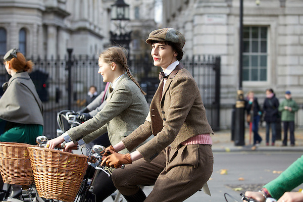 Erin O'Connor and a model bicycle down Whitehall and past Number 10 Downing Street during The Tweed Run