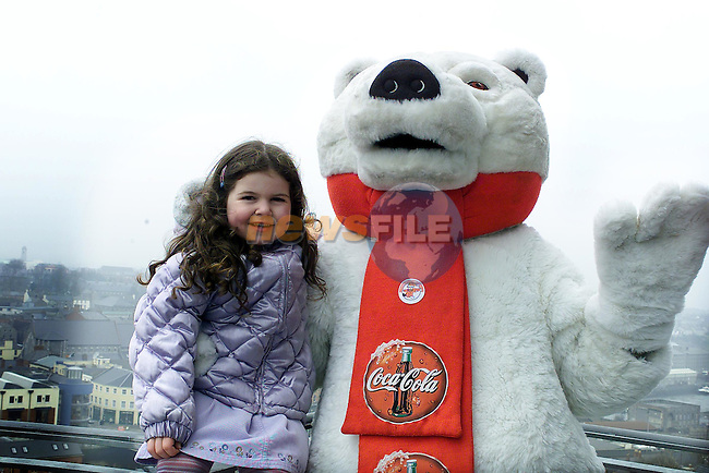 Niamh Duffy with the Coca Cola Bear.Pic Fran Caffrey Newsfile..Camera:   DCS620X.Serial #: K620X-00546.Width:    1728.Height:   1152.Date:  24/3/01.Time:   16:00:32.DCS6XX Image.FW Ver:   3.2.3.TIFF Image.Look:   Product.Sharpening Requested: Yes.Counter:    [5610].Shutter:  1/160.Aperture:  f10.ISO Speed:  400.Max Aperture:  f2.8.Min Aperture:  f22.Focal Length:  28.Exposure Mode:  Manual (M).Meter Mode:  Color Matrix.Drive Mode:  Continuous High (CH).Focus Mode:  Continuous (AF-C).Focus Point:  Center.Flash Mode:  Normal Sync.Compensation:  +0.0.Flash Compensation:  +0.0.Self Timer Time:  10s.White balance: Auto.Time: 16:00:32.007.