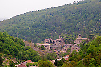 The village of Malleval with the old stone church and stone and ochre coloured houses in one of the valleys leading down to the Rhone river.  Domaine Pierre Gaillard, Malleval, Ardeche, Ardeche, France, Europe