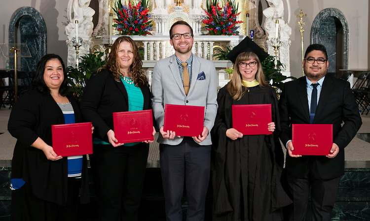 Left to right, Tania Rodriguez, Karolynn Horan, Daniel Stanford, Heather Jagman and Ruben Picazo were presented with Staff Quality Service Awards during DePaul's annual Academic Convocation at the St. Vincent de Paul Parish Church Thursday, Sept. 1, 2016. The Rev. Dennis H. Holtschneider, C.M., president of DePaul University, presented the awards to faculty and staff. (DePaul University/Jeff Carrion)