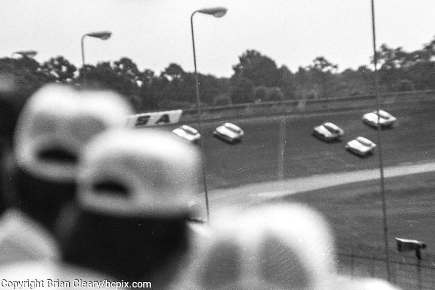 Fans watch the action, 1978 Firecracker 400 NASCAR race, Daytona International Speedway, Daytona Beach, FL, July 4, 1978.  (Photo by Brian Cleary/ www.bcpix.com )