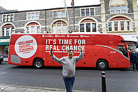 Pictured: A man gives the fingers in front of the Labour campaign bus in Barry. Saturday 07 December 2019<br /> Re: Labour Party leader Jeremy Corbyn pre-election campaign in Barry, south Wales, UK.