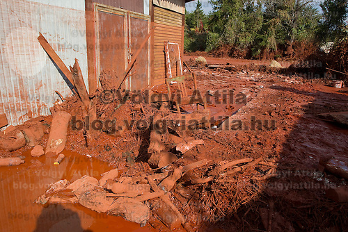 Devecser in Hungary's Veszprem county has been flooded by toxic sludge released by a dam accident in a nearby container. The toxic chemicals left its red marking on all the walls of the houses in and out and covered all moveable belongings and streets killing people and animals. Red sludge is a waste from bauxite fefining that has a strong caustic effect. The toxic flood covered an area of over 800-1,000 hectares (1,920-2,400 acres). Six people were killed and more than 150 injured in the disaster. Pollution from the red sludge now spread into the local rivers killing all life in rivers Marcal and Torna and now it mixed into the main European waterway river Danube. Officials say there is no risk of a biological or enviromental catastrophe there.  Devecscer, Hungary, Monday, 11. October 2010. ATTILA VOLGYI