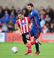 Lincoln City's Jack Payne vies for possession with Sunderland's Conor McLaughlin<br /> <br /> Photographer Chris Vaughan/CameraSport<br /> <br /> The EFL Sky Bet League One - Lincoln City v Sunderland - Saturday 5th October 2019 - Sincil Bank - Lincoln<br /> <br /> World Copyright © 2019 CameraSport. All rights reserved. 43 Linden Ave. Countesthorpe. Leicester. England. LE8 5PG - Tel: +44 (0) 116 277 4147 - admin@camerasport.com - www.camerasport.com