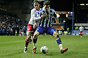 Lewis Buxton of Sheffield Wednesday holds off Lawrie Wilson of Stevenage. - Sheffield Wednesday v Stevenage - npower League 1 - Hillsborough, Sheffield - 14th February 2012  .© Kevin Coleman 2012