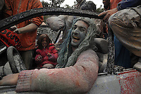 Feb.27, 2012 - Galaxidi, Greece. Face-painted man drives a traditional 'carnival' car, carrying the revelleres who throw flour and colored powder during the annual 'flour-war' celebrating the 'clean Monday'. It is the day that marks the end of the carnival season and the start of the 40-day Lent period of the Orthodox Easter (Foto Insidefoto / Maro Kouri / Anatomica Press) .A Galaxidi, in Grecia, si è svolta la battaglia della farina, Clean Monday o Pure Monday, che segna la fine del carnevale..ITALY ONLY