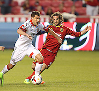 Kyle Beckerman #5 of Real Salt Lake defends Chris  Pontius #13 of D.C. United during the first half of the U.S. Open Cup Final on October  1, 2013 at Rio Tinto Stadium in Sandy, Utah.