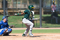 Oakland Athletics second baseman Marcos Brito (5) follows through on his swing during an Instructional League game against the Los Angeles Dodgers at Camelback Ranch on September 27, 2018 in Glendale, Arizona. (Zachary Lucy/Four Seam Images)